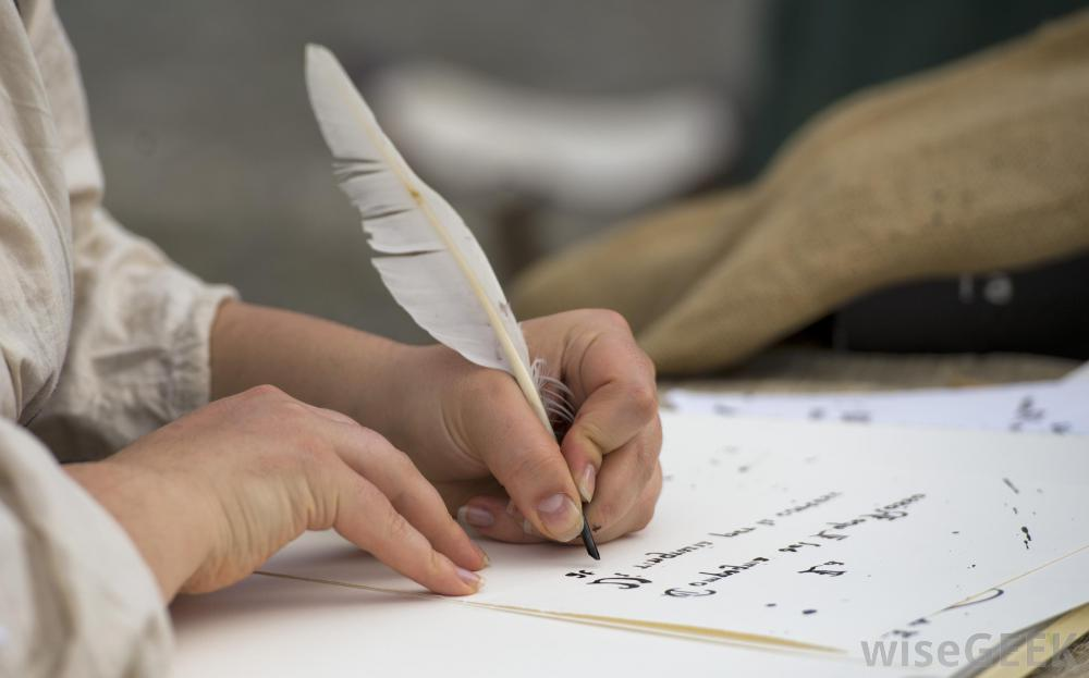 person-with-white-quill-and-paper